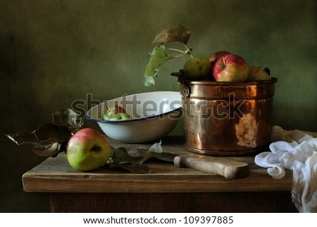 Still life with a copper bucket - stock photo