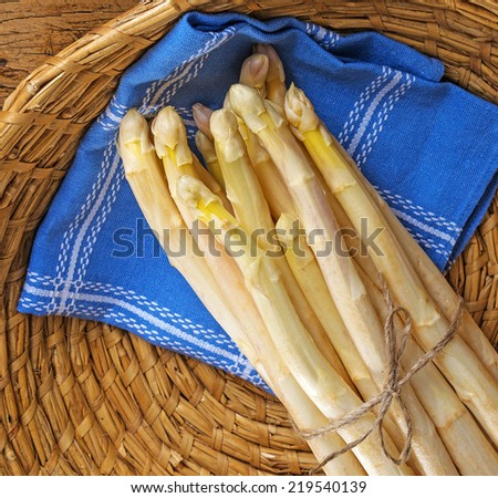 still life with a fresh white asparagus in a basket - stock photo