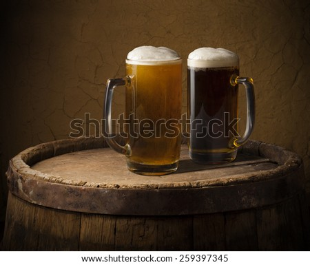 Still Life with a keg of beer and draft beer by the glass. - stock photo