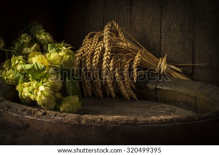 Still life with a keg of beer and hops. - stock photo