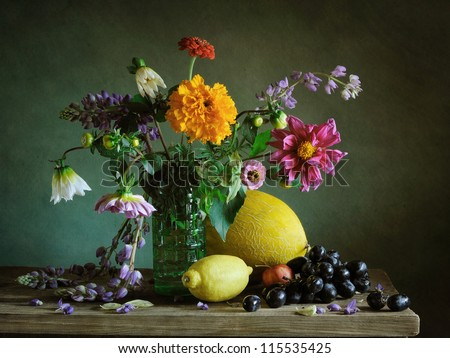 Still life with a lemon and a melon - stock photo