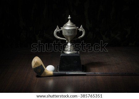 Still Life with a old trophy. golf club and ball
