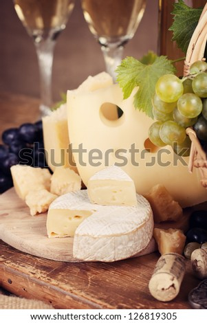 Still life with a variety of cheeses, parmesan, camembert - stock photo