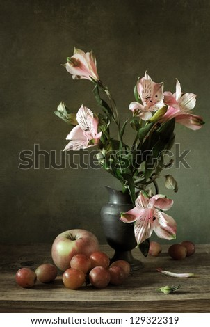 Still life with alstroemeria and fruit - stock photo