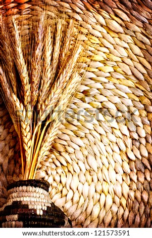 still life with and ears of wheat/composition with natural  ears of rye on a vintage on vine woven  basket background/