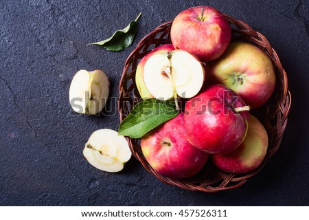 Still life with apple in basket on stone background