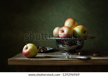 Still life with apples and nuts - stock photo