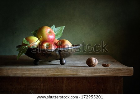 Still life with apples and walnuts - stock photo