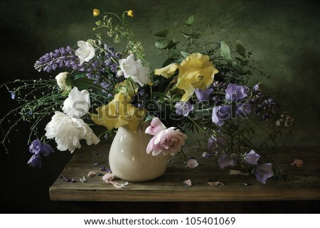 Still life with as voluptuous bouquet of flowers - stock photo