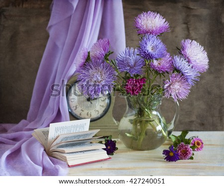 Still life with asters and clock - stock photo