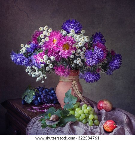 Still life with asters and snails - stock photo