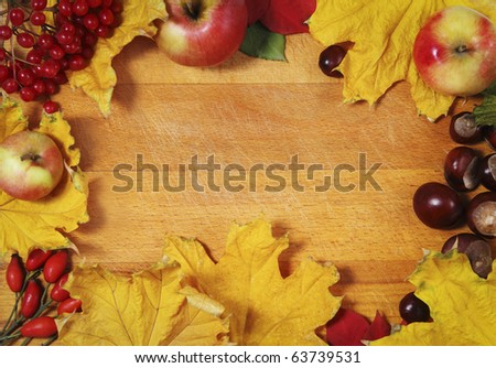 Still life with aunumn leaves over wooden background - stock photo