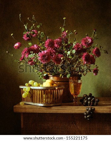 Still life with autumn flowers in a copper bucket - stock photo