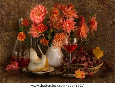 Still life with autumn flowers, melon, grapes and wine - stock photo