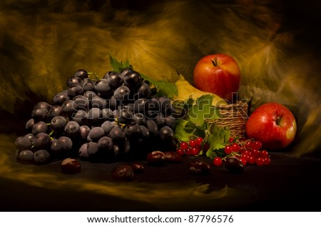 Still life with autumn vegetables and fruits on black background - stock photo