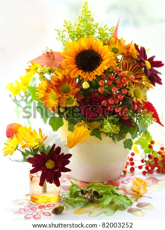 still life with autumnal flowers and berries - stock photo