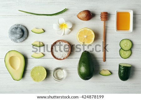 Still life with avocado oil on wooden table, top view - stock photo