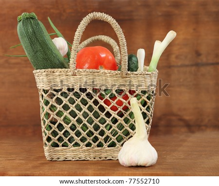 Still life with basket of the fresh vegetables - stock photo