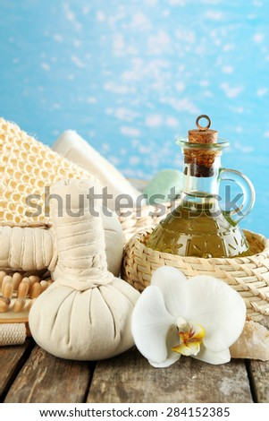 Still life with beautiful blooming orchid flower, spa treatment on bright background - stock photo