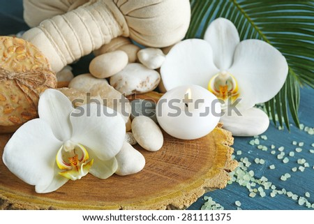 Still life with beautiful blooming orchid flower, spa treatment on wooden background - stock photo