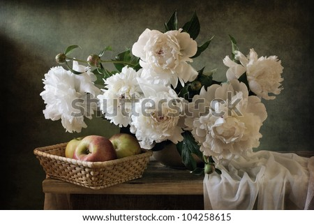 Still life with beautiful peonies and apples - stock photo