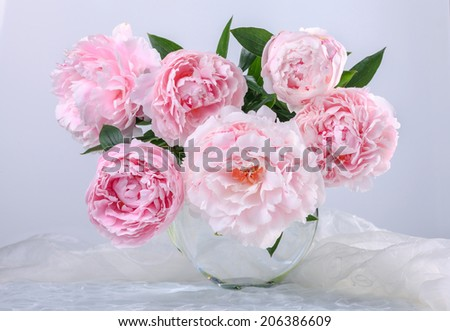 Still life with beautiful pink peonies in green vase - stock photo