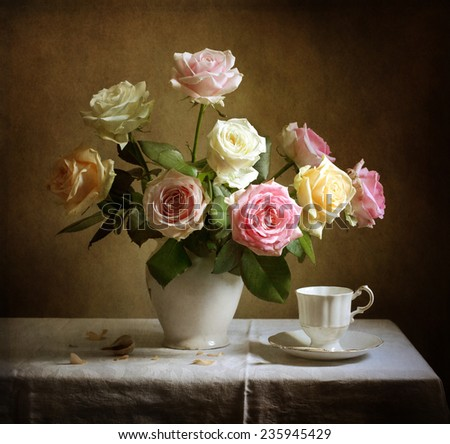 Still life with beautiful roses and a cup of tea - stock photo