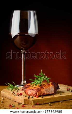 still life with beef steak and glass of red wine - stock photo