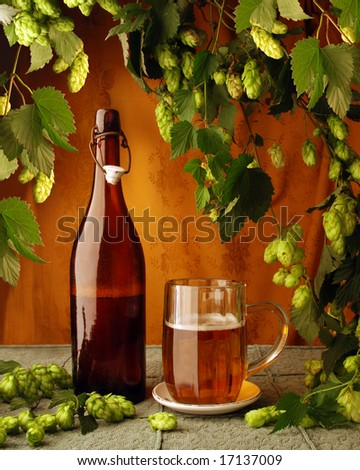 Still life with beer and hop-plant in retro style - stock photo