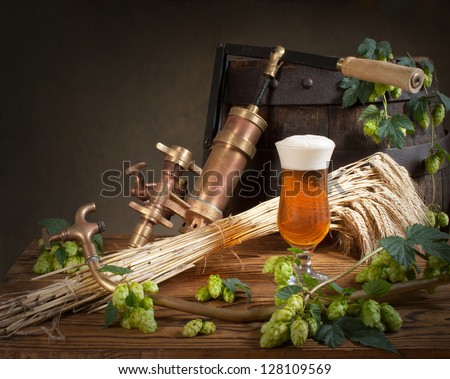 still life with beer and hops - stock photo