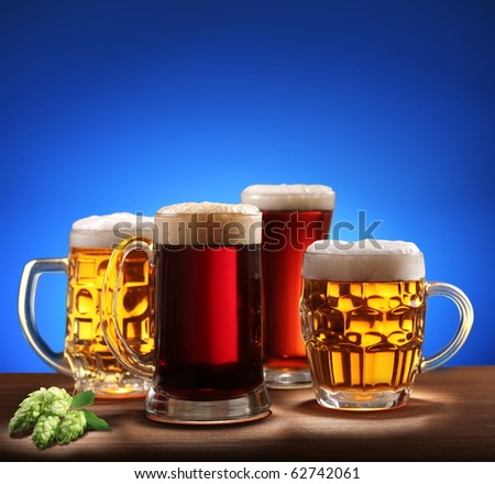 Still-life with beer glasses. On a blue background. - stock photo