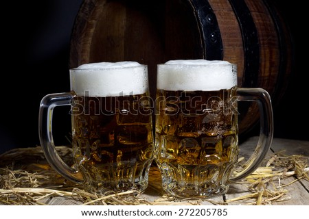 Still Life with Beer Mugs and Barrel on Black Background - stock photo