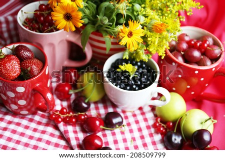 Still life with berries and flowers
