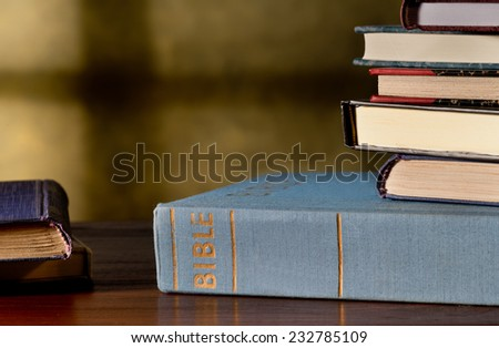 still life with bible and books in the church - stock photo
