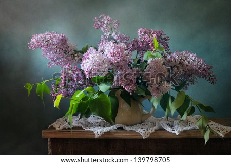 Still life with blooming lilac brunches - stock photo