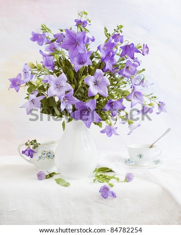 Still life with bluebells on painting background - stock photo