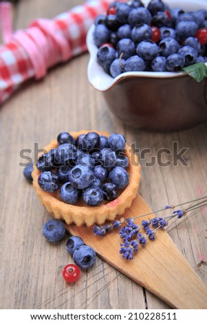 still life with blueberries and red currant on the rural style table