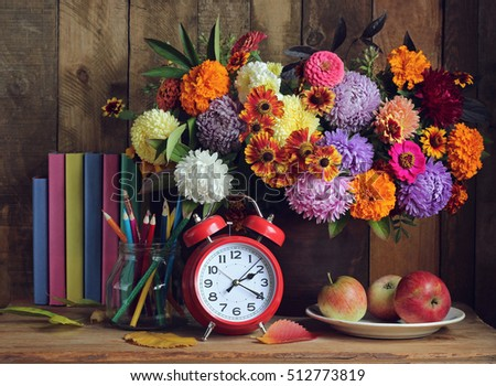 Still life with books and bouquet. Back to school. September 1, Knowledge Day. The Teacher's Day.