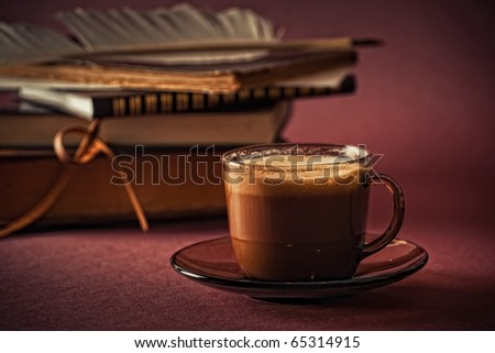 Still life with books and cup of coffee