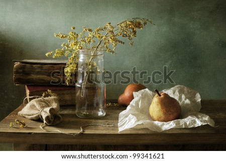 Still life with books and pears - stock photo