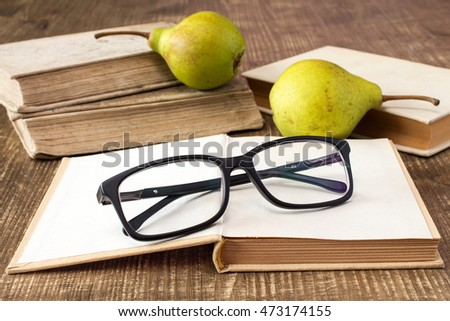 Still life with books, glasses and pears