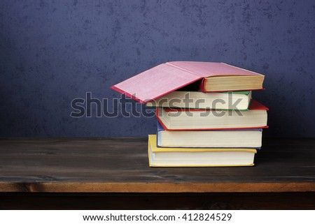 Still life with books on the table. A stack of books, an open book. Training, education.