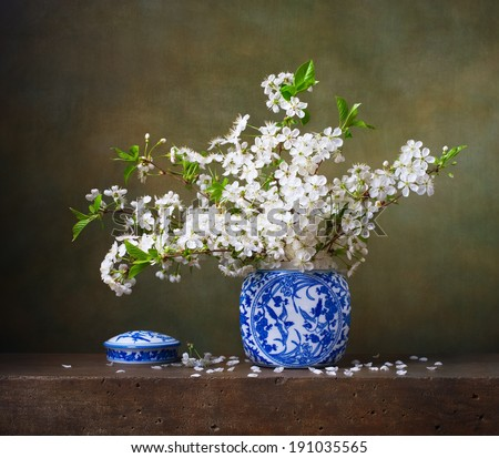 Still life with bouquet of cherry blossoms in a chinese vase - stock photo