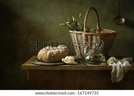Still life with bread and a bottle of oil - stock photo