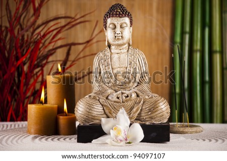 Still life with buddha statue - stock photo