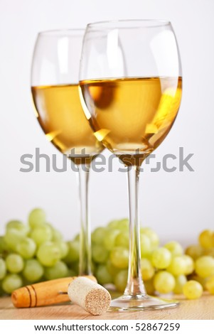 Still-life with bunch of grapes and white wine - stock photo