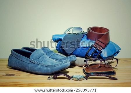 Still life with casual man on wooden table over grunge background