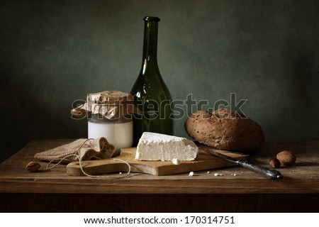 Still life with cheese, bread and milk - stock photo
