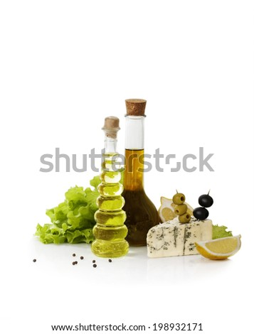 Still-Life With Cheese, Oil, Olives and Cheese n the white Background - stock photo