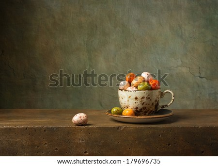 Still life with chocolate easter eggs - stock photo